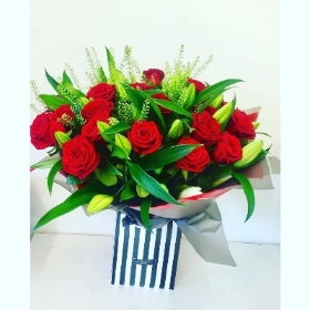 Red rose and pink lily handtied